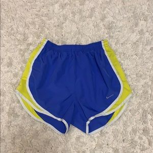 Blue and yellow Nike sports shorts